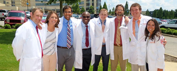 8 members of the class of 2016 standing together outside the Family Medicine Center