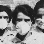 old photo of people wearing breathing masks