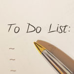 "Pen resting on paper that says ""to do list"""